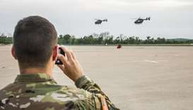 Texas National Guard helicopters traveling to the Texas-Mexico border fly off  in Austin
