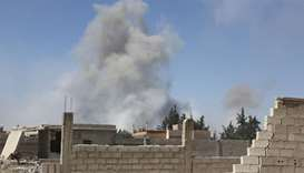 Smoke billows in the town of Douma, the last opposition holdout in Syria's Eastern Ghouta