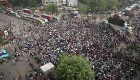Bangladeshi university students block a road during a protest against the quota system used in gover