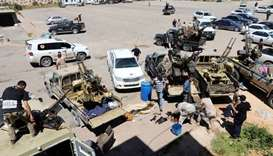 Members of Misrata forces, under the protection of Tripoli's forces, prepare themselves to go to the