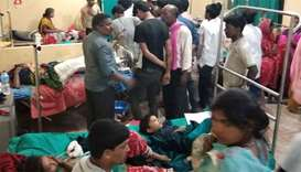 Victims of a thunderstorm undergo treatment at a hospital in Parsha District, Nepal