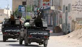 Members of Libyan internationally recognised pro-government forces ride in military vehicles on the