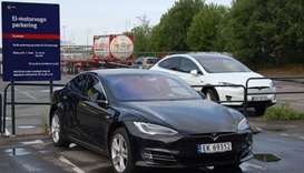 Model S (L) and Model X (R) electric cars of US car maker Tesla parked on a parking in Oslo, Norway