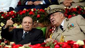 Algeria's President Abdelaziz Bouteflika gestures while talking with Army Chief of Staff General Ahm