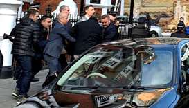 WikiLeaks founder Julian Assange is carried by Metropolitan Police officers