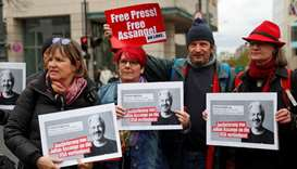 Supporters of WikiLeaks founder Julian Assange protest against his arrest, near the British embassy