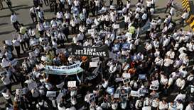 "Jet Airways employees hold placards and banners during a protest demanding to ""save Jet Airways"" at"
