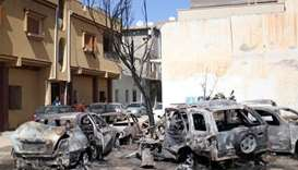 Vehicles damaged by an overnight shelling are seen in Abu Salim district in Tripoli, Libya