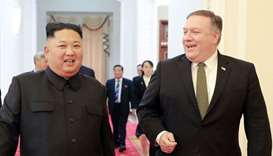 North Korea's leader Kim Jong Un (L) with US Secretary of State Mike Pompeo (R)