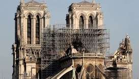 View of the rear of Notre-Dame Cathedral after a massive fire devastated large parts of the gothic s