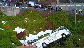 A video grab obtained from drone footage shows the wreckage of a tourist bus that crashed in Canico,