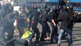 Riot police drag a protester during a demonstration on Act XXIII (the 23rd consecutive national prot