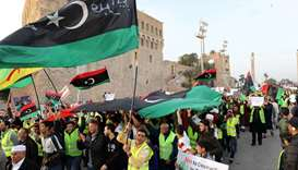 Libyan protesters attend a demonstration to demand an end to the Khalifa Haftar's offensive against