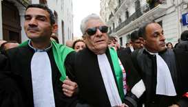 Mustapha Bouchachi marches in Algiers with others during a protest to demand the immediate resignati