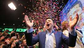 Ukrainian presidential candidate Volodymyr Zelenskiy reacts following the announcement of the first