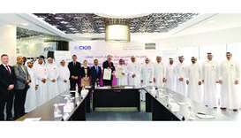 Officials of Ashghal, Chartered Institute of Building (CIOB) with and other dignitaries at the signi