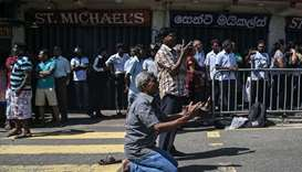 People pray outside the St. Anthony's Shrine in Colombo