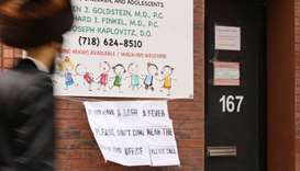 A sign warns people of measles in Williamsburg