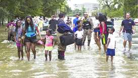 An August 31, 2017, file photo of families being evacuated in Houston.