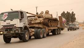 A tank belonging to the Libyan internationally recognised government forces arrives during the fight