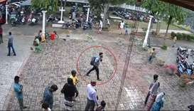 CCTV footage shows the suspected bomber (C) with backpack on his way to enter St. Sebastian's Church