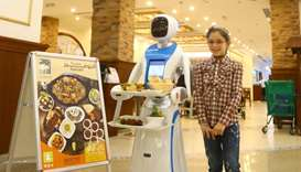 Emy ­­— the robot waitress, both attracts and serves customers