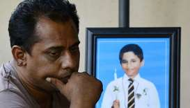Ranjeewa Silva 46, father of St Sebastian's Church suicide blast victim Enosh Silva, 12, cries next