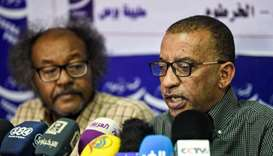 Sudanese civil society activists Muawia Shaddad (L) and Omar el-Digeir (R), two of the leaders from