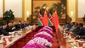 Kenyan President Uhuru Kenyatta and Chinese President Xi Jinping attend the meeting at the Great Hal