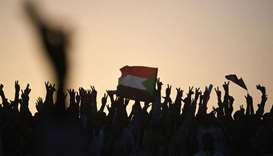 "Sudanese protesters chant slogans as they gather for a ""million-strong"" march outside the army headq"