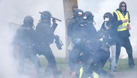 Riot police detain protesters as they clash at a demonstration during the Act XXIV of the yellow ves
