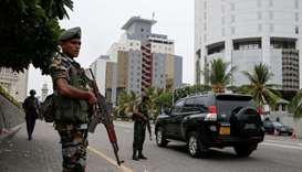 A security officers patrol outside a luxury hotel, days after a string of suicide bomb attacks acros