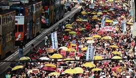 Activists attend a protest in Hong Kong against a controversial move by the government to allow extr