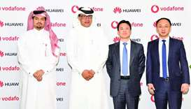 Sheikh Hamad, al-Misnad and Yang during the strategic agreement signed between Vodafone Qatar and Hu