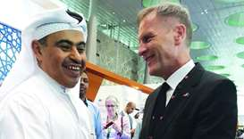 German ambassador Hans-Udo Muzel (right) with Qatar's Minister of Commerce and Industry HE Ali bin A