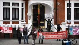 Supporters of WikiLeaks founder Julian Assange display banners and placards as they gather outside t