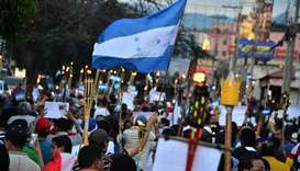 Thousands protest against Honduras president