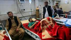 An injured man receives treatment in a hospital, after twin explosions in Jalalabad