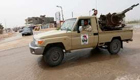 A military vehicle of Misrata forces, under the protection of Tripoli's forces, is seen on the road