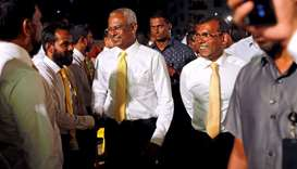 Maldives President Ibrahim Mohamed Solih and former president Mohamed Nasheed arrive at an election