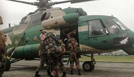 Chinese soldiers board on a helicopter in Chengdu in Sichuan province  as they prepare to rescue fir
