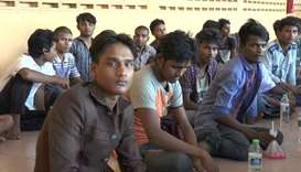 A group believed to be Rohingya Muslims from Myanmar are seen in a border security office, before be