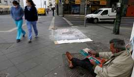 Homeless, and self-taught-painter Humberto Vasquez,58, is seen on the street painting his pictures d