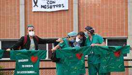 Healthcare workers confort the wife of Esteban, a male nurse that died of coronavirus at the Severo