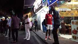 "People gathering on a street in the ""Little Africa"" district in Guangzhou, the capital of southern C"