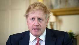 A handout image released by 10 Downing Street, shows Britain's Prime Minister Boris Johnson as he de