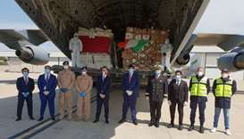 Dignitaries and military officers upon the arrival of the medical aid from Qatar