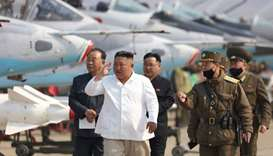 North Korean leader Kim Jong Un visits a pursuit assault plane group under the Air and Anti-Aircraft