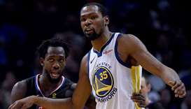 File photo of Kevin Durant (right) of the Golden State Warriors and Patrick Beverley of the LA Clipp