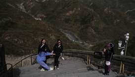 Visitors pose for pictures, following the coronavirus disease (COVID-19) outbreak, at the Badaling s